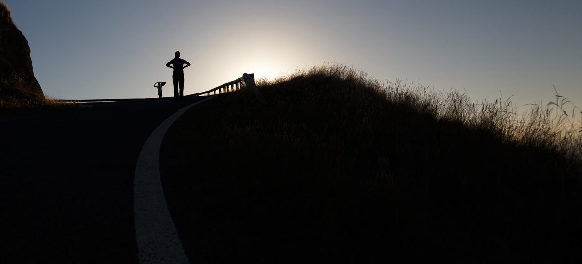 person silhoutted against a sunset